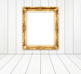 blank golden frame in room with white wood wall and wood floor
