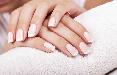 Beautiful woman's nails with french manicure. Wall mural