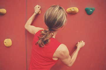 Young woman bouldering