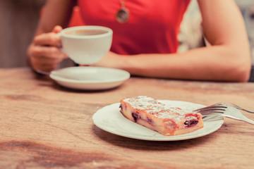 Woman having coffee and cake