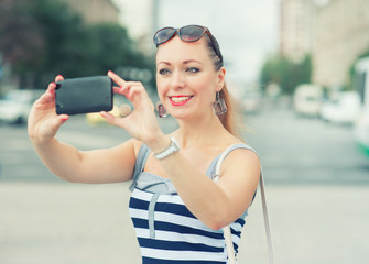 Beautiful woman taken picture of herself in the city