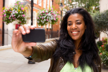 african american woman taking a selfie.