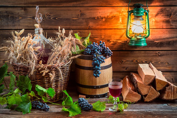 Grapes and red wine in a demijohn