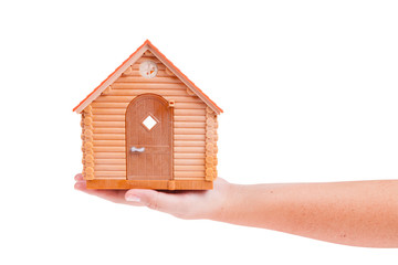 House model in the hand isolated on white background