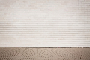 Light brown brick wall texture with walkway.