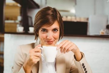 Pretty businesswoman enjoying her coffee