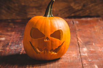 Halloween pumpkin on wooden rustic background