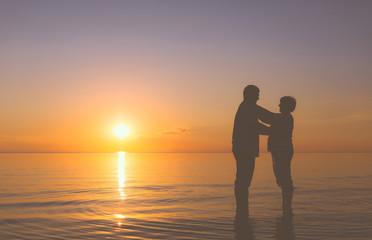 Senior couple at sunset