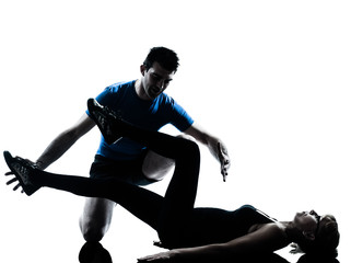 Wall Mural - aerobics intstructor  with mature woman exercising silhouette