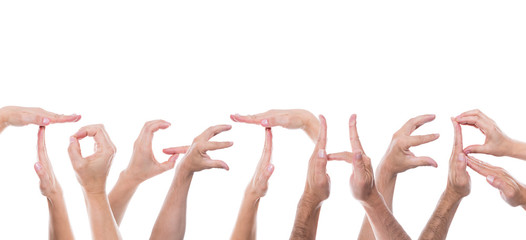 lot of hands form the word together