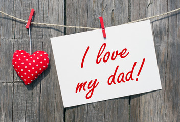 I love my dad - Postcard on wooden background