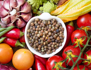 Raw organic roveja beans and vegetables