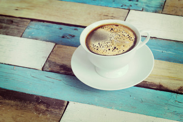 coffee served in a white cup on wooden table