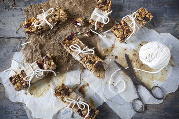 homemade rustic granola bars on vintage wooden background