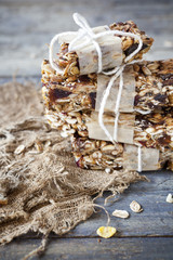 stack of homemade granola bars on vintage background