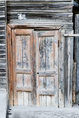 Ancient wooden door. Wooden door of old barn