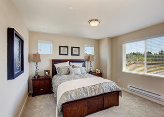 Modern bedroom furniture in bright room with window