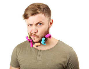 Portrait of handsome man with beard of curlers isolated on