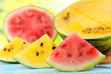 Slices of red and yellow watermelons