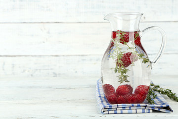 Tasty cool beverage with raspberries and thyme,