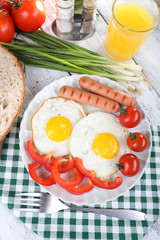 Scrambled eggs with sausage and vegetables served