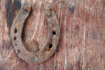 Wall Mural - Old horse shoe on wooden background