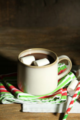 Hot chocolate with marshmallows, on wooden background