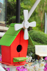 Wooden bird house with the nature