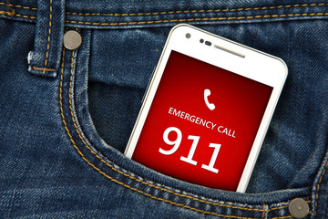 mobile phone in pocket with emergency number 911. focus on scree