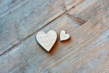 Two Wooden Hearts on Wooden Background