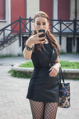 Pretty goth girl taking a selfie with her phone