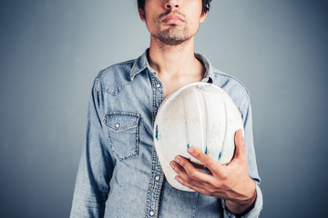 Proud worker with hard hat