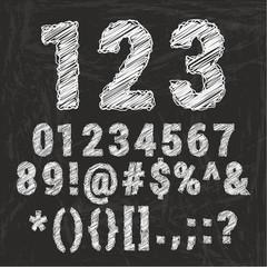 Chalk alphabet on black background.