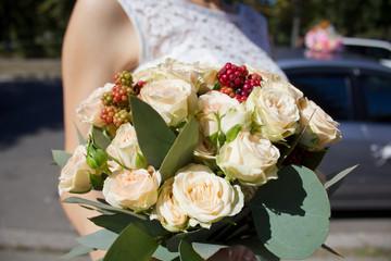 Bride holding wedding flower with blackberry bouquet