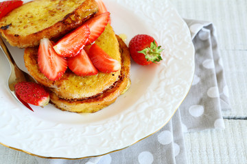 stack of toast with honey and strawberries