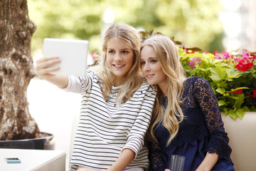 Happy young girls take selfie