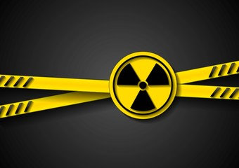 Danger tape abstract background with radiation symbol
