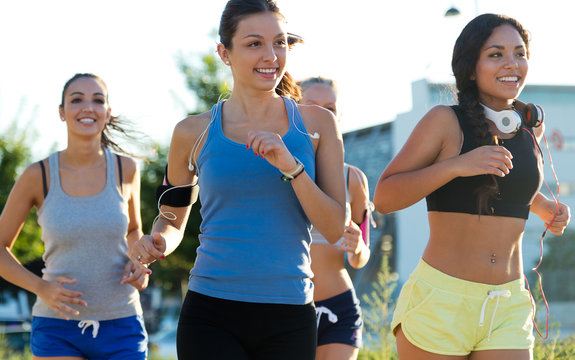 Group of women running in the park.