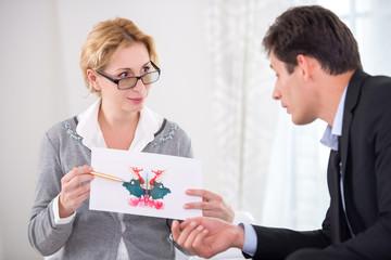 Female psychotherapist holding Rorschach Test