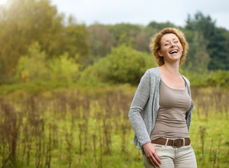 Beautiful woman laughing in the countryside