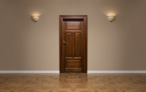 Closed wooden door in the empty room with copy space