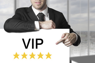 businessman pointing on sign vip golden stars
