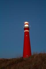 Fototapete - lighthouse at night, Schiermonnikoog island