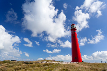 Wall Mural - red lighthouse oer blue sky