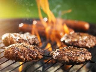 Aluminium Prints Grill / Barbecue hamburgers and hotdogs cooking on flaming grill