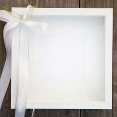 Empty White Square Picture Frame with Bow