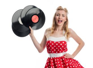 Jubelnde Frau hält Schallplatten