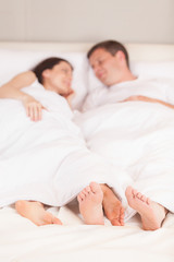 young lovely couple lying in bed.