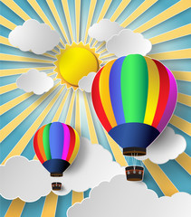 Hot air balloon high in the sky with sunlight