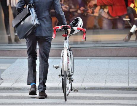 Office worker on his way home with bike